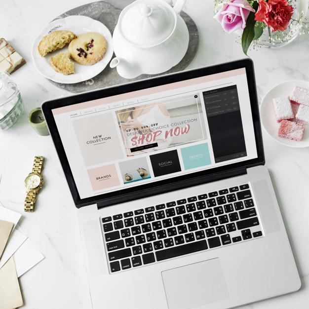 Laptop Online Shopping Teapot Cookies Flower Decor Concept